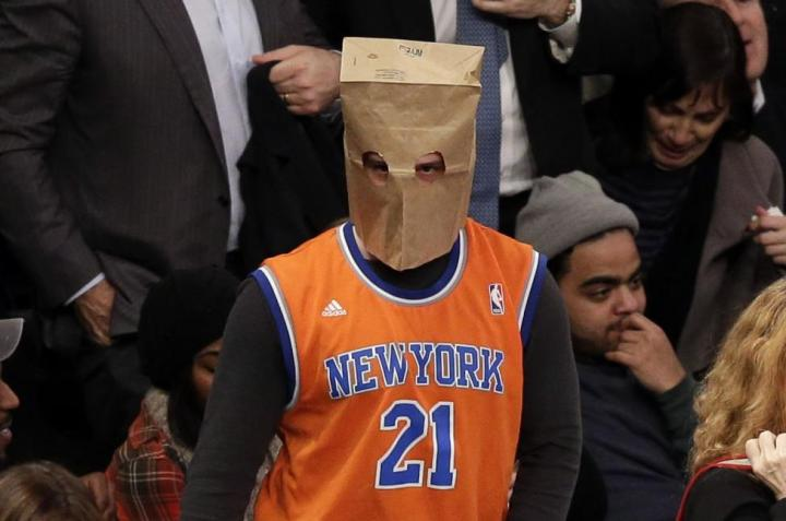 Photos-Fans-hide-faces-behind-paper-bags-as-hapless-Knicks-lose-14th-straight-game.jpg